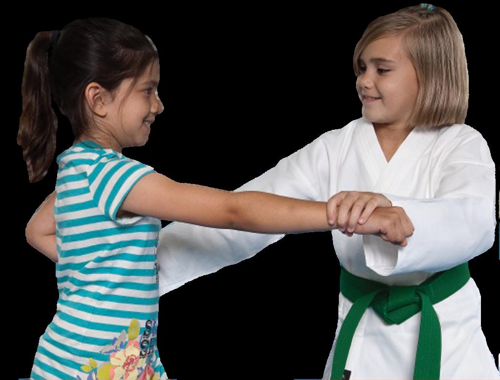 Karate student helping friend.